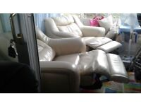 Two cream leather electric recliner chairs