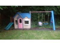 Little Tikes playhouse with swings and slide.