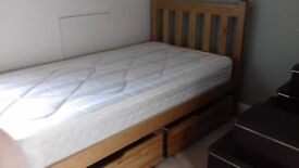 single pine bed with free standing drawers and lowry mattress