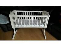 White swing crib
