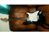 Electric guitar and padded case