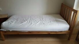 Single wooden frame bed with mattress, £25, collection only.