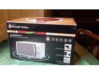 Microwave Brand New. Box never been opened. (House move fell through) Russell Hobs 700 watt