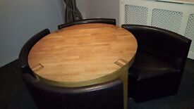Beautiful solid wood table with 4 brown space saver chairs. Great price, great condition.