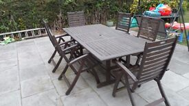 LARGE HARDWOOD GARDEN TABLE AND SIX CHAIRS INCLUDES PARASOL JUST OVER 7 FOOT LONG