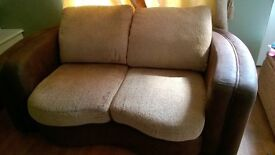 2 Seater Brown Fabric Sofa.
