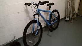 Carrera Vulcan bicycle, light blue, 21 speed, disc brakes with front suspension, as new.