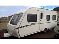 Abbey Vogue 495 2008 4 birth fixed bed, very good condition. Includes awning and reich motor mover.