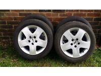 Ford Focus wheels. 5 Spoke, 5 Stud Steel Wheels with Trims. 4 Good Road Legal Tyres.20 X Wheel Nuts.