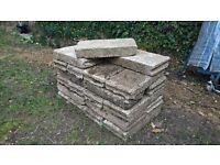 Reclaimed concrete paving slabs
