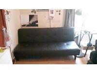 Faux leather sofa/futon