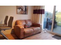 2 seat tan sofa dfs Caesar rrp995