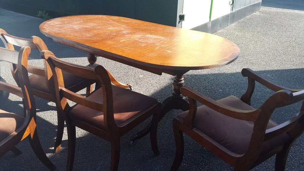 Mahogany table with six chairs, two carvers. bought 1974
