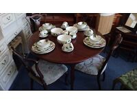 Extending round table with 4 antique decorative chairs