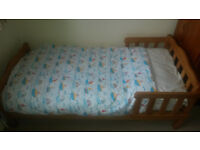 Mothercare pine toddler bed with mattress and bedding included.