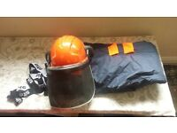 chainsaw trousers and helmet