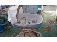 Baby moses basket and wooden stand.