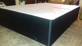 Brand new small double divan base, black fabric, without drawers
