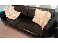 Leather/faux 3 seater sofa.