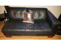 One section of black leather corner sofa
