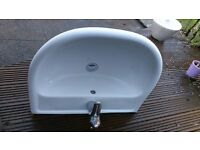 Wall mounted white ceramic sink including tap and waste fitments