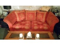 Two lovely red 3 seater cushion back settees