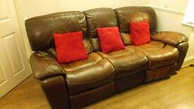Leather 3 seat reclining sofa and matching reclining armchair