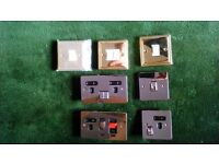 selection of polished brass & chrome effect electrical switches , soctets & outlets
