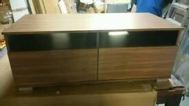 A brand new stylish walnut effect finish 2 drawer TV unit.