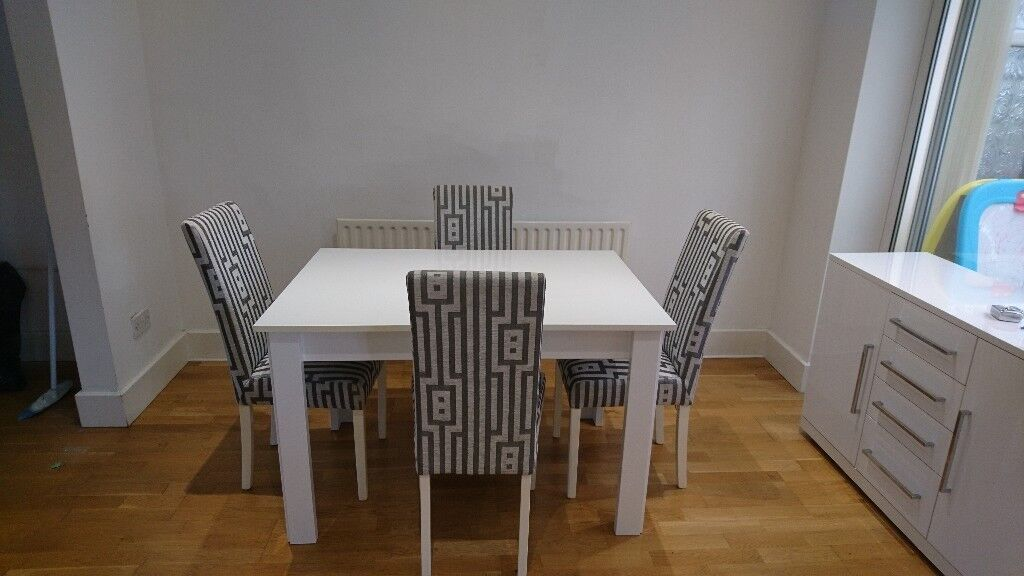 White Gloss Dining Table With 4 Grey And Patterned Chairs