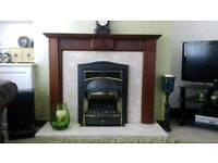 Mains gas fire with surround