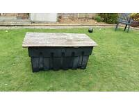 Garden storage: Water tank with wooden top suitable for storage