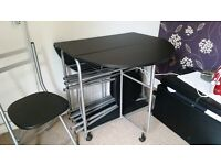 black/chrome table and 4 chairs (stackable underneath)