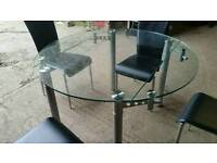 Round Glass Extendable Dining Table and 4 Chairs