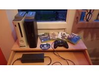 2 XBOX 360's with 5 games, controller with plug and play kit and wireless adapter