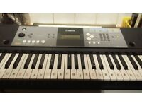 Yamaha electric keyboard with stand.