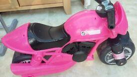 Pink ride on motorbike
