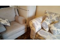 4-seater SCS sofa blue/grey b/g, white floral design, and armchair in contrast.