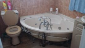 Cream bathroom suite complete with spa jets