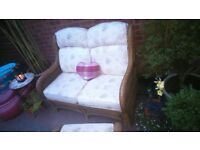 Lovely conservatory/semi outdoor settee and matching foot stool. As new condition