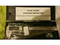 brand new digital caliper micrometer in storage box