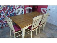 Farmhouse kitchen table with end extensions and six chairs