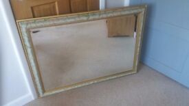 Large green and gold framed mirror