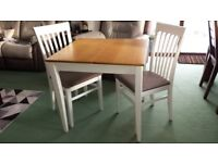 Extending table with two chairs