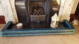 Fireplace Fender. Decorative Victorian tiles.