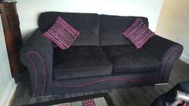 Black Sofa and Swivel Chair