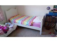 White single bed. Sprung slats.