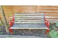 Garden bench cast iron ends wooden slats. Needs overhaul.
