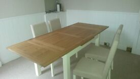 Nearly new Dfs oak dining table with 4 chairs