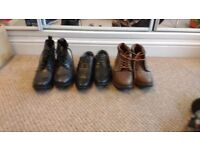 Two pairs of boots, and one pair men's dress shoes